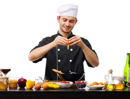A large young guy, the chef, breaks the egg into a black plate.