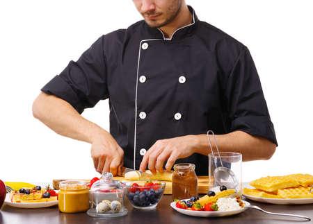 Close-up of a chef slicing an appetizing banana. Banco de Imagens