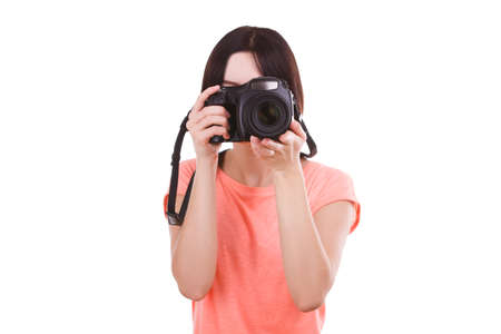 A girl is looking into the camera on a white isolated background. Front view