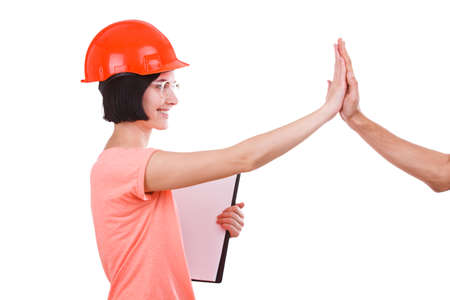 Girl contractor gives five and looks directly on white isolated background