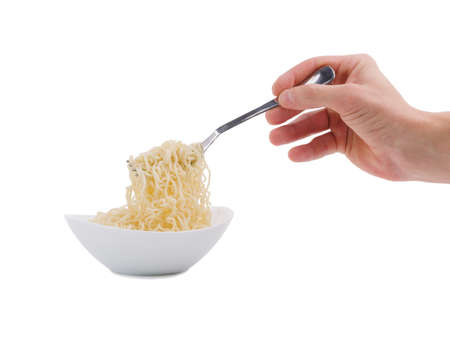 Hand is picking up noodles with a fork on a white isolated background