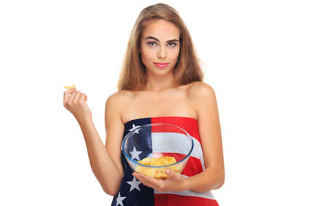 Young blond woman holding potato chips in a transparent plate isolated on a white background