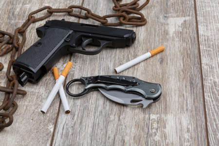The rusty chain, a pistol, ammunition and several cigarettes.