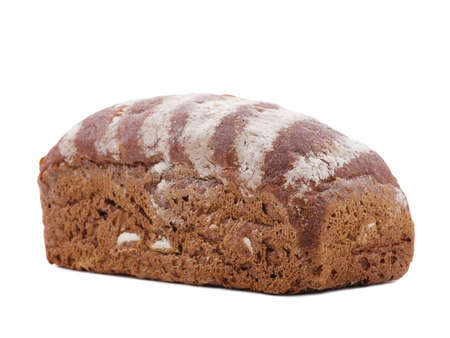 Bun of black bread lying unevenly close-up on a white isolated background