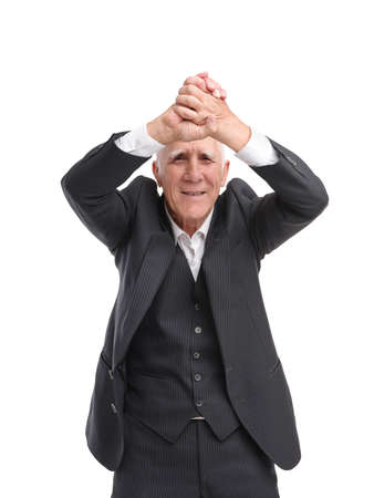 Grandfather very happy and raised his hands over his head against a white isolated background