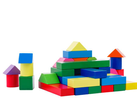 A house in the form of a pyramid for a child from wooden bright geometric shapes, colorful cubes, the development of the motor hand of a child, a view from the front, isolated on a white background.