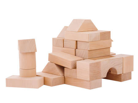 A small castle for a child from wooden geometric shapes, the development of the hand motor skills of a child, isolated on a white background.