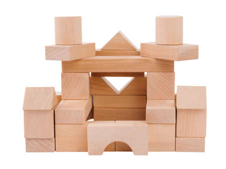 Great castle for a child from wooden geometric shapes, the figures are superimposed on each other, the view of the castle from behind, the development of motor skills, isolated on a white background 写真素材