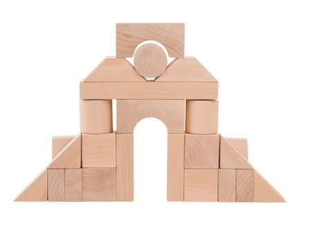 Wooden toys from which build a childrens arch, child development, cubes, with towers, front view, isolated on white background. Stock Photo