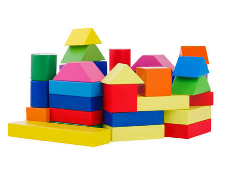 A pile of colored geometric shapes superimposed on each other, a child built of wooden, geometric figures of a settlement, the development of the motor hand of a child, isolated on a white background 写真素材