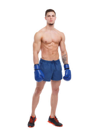 Muscular guy in boxing gloves on white isolated background Stock Photo