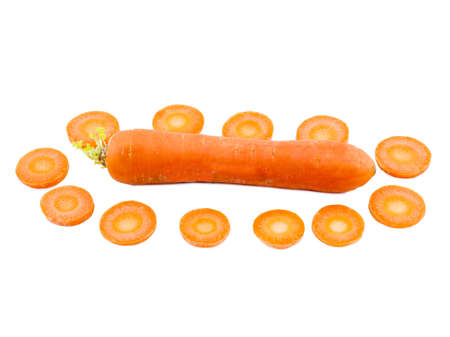 Carrots whole lies horizontally close-up next to slices of round carrots around on white isolated background Stock Photo