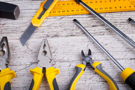 The layout of various construction tools of yellow and black colors. View from above. Stock Photo