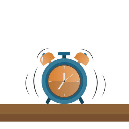 A ringing alarm clock on a brown wooden table