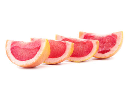 Grapefruit halves isolated on a white background. Fresh, organic, exotic and juicy slices of grapefruits full of vitamins. Citrus fruits for healthy snack. 스톡 콘텐츠