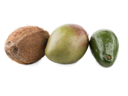 Fresh and whole coconut, mango and avocado isolated on a white background. A concept of exotic fruits full of vitamins