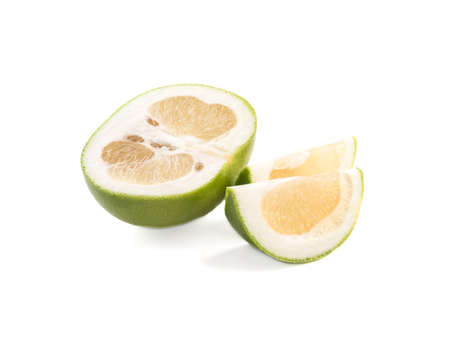 Green slices of ripe and fresh grapefruit isolated on white background. A concept of citrus fruits full of vitamins