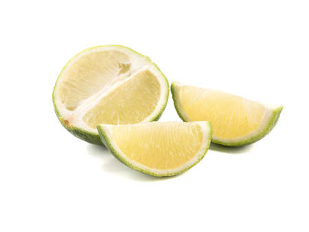 Green slices of ripe and fresh lime isolated on white background. A concept of citrus fruits full of vitamins 스톡 콘텐츠