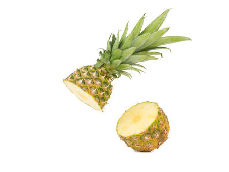 A sliced ripe and juicy tropical Hawaiian pineapple isolated on a white background. Exotic fruits comcept