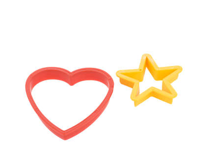 Close-up of colorful cookie cutters isolated on a white background. Gingerbread and pastry cutters in star, heart, man form.