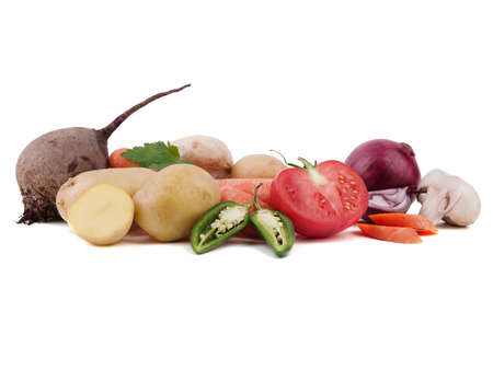 Fresh and organic vegetables isolated on a white background. Tomatoes, onions, mushrooms, potatoes, pepper, cabbage, beetroot and parsley for salad.
