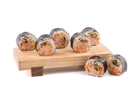 A set of sushi rolls on a wooden board isolated on white background. A concept of seafood and Japanese cuisine. Reklamní fotografie