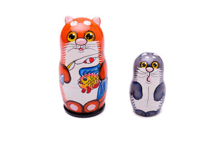 Set of Russian nesting dolls in shapes of cat family.
