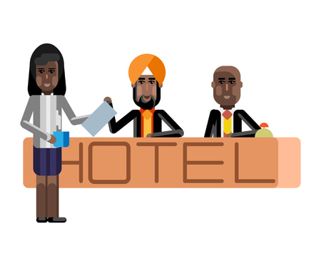 Indian receptionists at hotel reception desk
