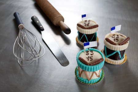 medium group of objects: Drums of chocolate and pastry tools Stock Photo