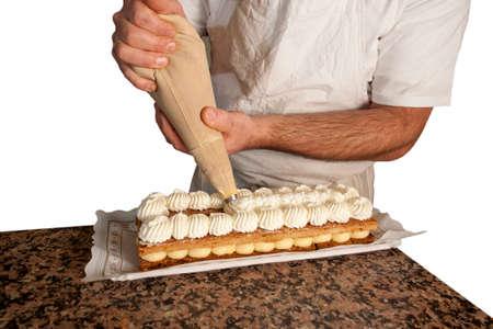 pasteleria francesa: crema pastelera pone la manga pastelera