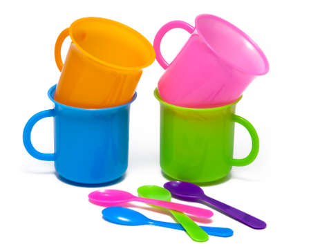 medium group of objects: Cups and spoons colors on white background