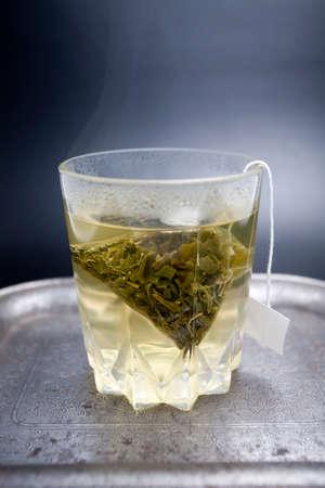 green background: Bag green tea leaves