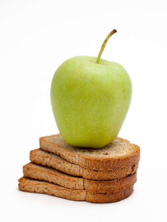 wheat toast: Golden apple on whole wheat toast on white background