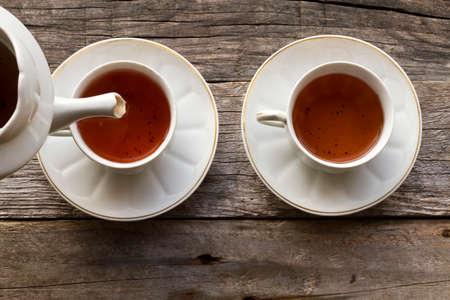 red tea: Serve cups of red tea