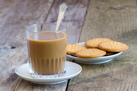 medium group of objects: Coffee with milk and cookies on rustic table Stock Photo