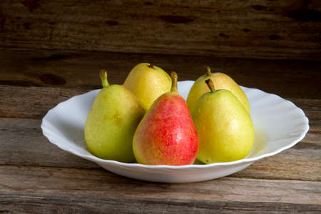 medium group of objects: pears in a bowl with rustic background