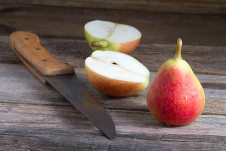 small group of objects: Pear cut in half on rustic background