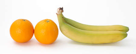 small group of objects: Two oranges and two bananas on white background