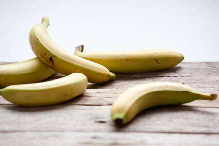 rustic: Bananas on rustic background Stock Photo