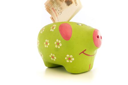 coffer: Piggy bank with money into it. Coffer Isolated on white. Stock Photo