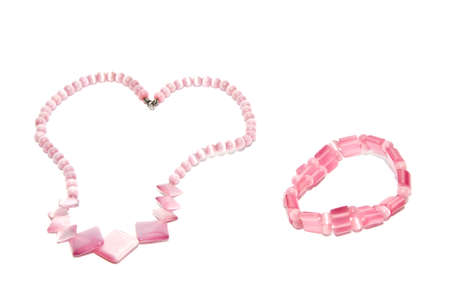 pink necklace on white background photo