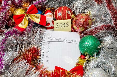 new years resolution: 2016 New Years resolution above Christmas decoration Stock Photo