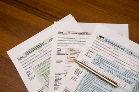 1040 tax return form on wooden table