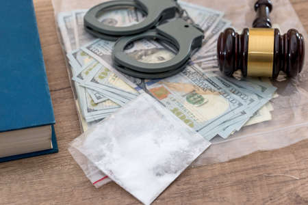 Drugs and substances prohibited, dollar, book, Judge gavel and handcuffs - arrest criminals