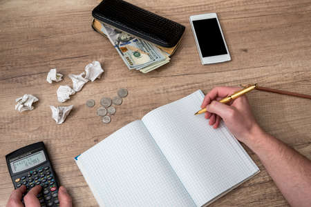 financial concept - blank notepad, calculator, pen and smartphone on the table Archivio Fotografico