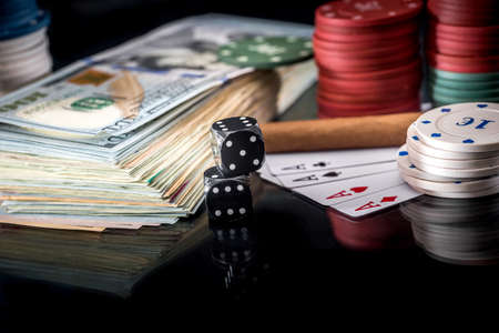 poker combinations - chips, money and card isolated on black 免版税图像