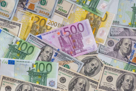 dollar and euro notes for background as business concept.