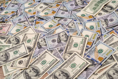 Background of 100 new and old dollar bills