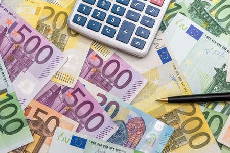 pen calculator and euro banknotes. close up