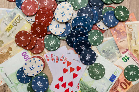 play card with euro bills, chips